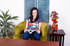 Cute Teen Girl Reading a Book Royalty Free Stock Photography