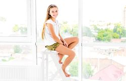 Cute Teen Girl Sits On Stepladder Stock Images