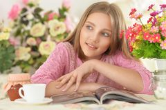 Cute teen girl sitting at table Royalty Free Stock Photo