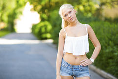Cute teen girl with top stands in the street Royalty Free Stock Photos