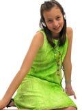 Cute teen girl wearing headphones Stock Photos