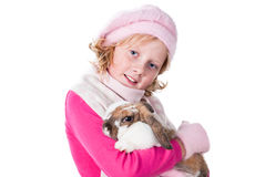 Cute teen girl winter clothes carrying rabbit Royalty Free Stock Photography