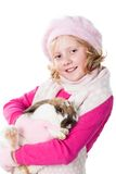 Cute teen girl winter clothes carrying rabbit Stock Photography