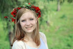 Cute teen girl with a wreath of spring flowers Stock Images