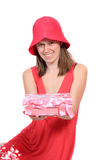Cute teen in a periwinkle color dress. Cute sixteen year old girl dressed in a periwinkle colored dress and hat holding a present box decorated with bows and Stock Photo