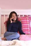 Cute teen on phone Royalty Free Stock Image