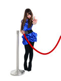 Cute teen stops showing stop gesture near event entrance. Nice girl near red rope barrier, stops someone with stop gesture sign Stock Photos