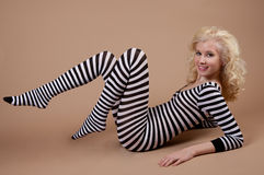 Cute Teen in Striped Bodysuit Stock Photo