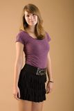 Cute teen wearing skirt. Seventeen year old girl poses with a smile Stock Image