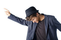 Cute teenage boy in dancing pose with hat Stock Photo