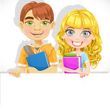 Cute teenage boy and girl with a textbook hold big banner Stock Photos