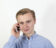 Cute teenage boy on a mobile Royalty Free Stock Photo