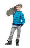 Cute teenage boy posing with skateboard Stock Images