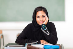 Female Arabic student. Cute teenage female Arabic high school student in classroom Royalty Free Stock Image