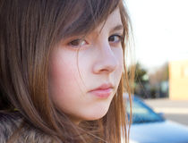 Cute Teenage Girl. Pretty teenage girl outside in golden sunlight with a serious expression stock photography