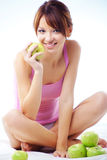 Cute teenage girl with apples. Portrait of cute cheerful teenage girl with green juicy apples stock photo