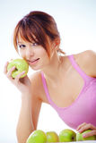 Cute teenage girl with apples. Portrait of cute cheerful teenage girl with green juicy apples stock photography