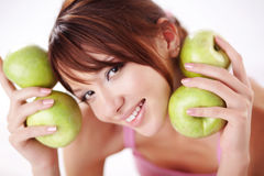 Cute teenage girl with apples Stock Images