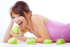 Cute teenage girl with apples Stock Image