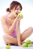 Cute teenage girl with apples Royalty Free Stock Photos