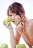 Cute teenage girl with apples Royalty Free Stock Photo
