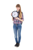 Cute teenage girl with backpack and clock isolated on white Royalty Free Stock Image
