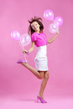 Cute teenage girl with balloons Royalty Free Stock Photos