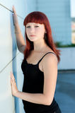Cute teenage girl in black outfit. Posing near wall outdoor Royalty Free Stock Images
