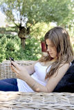 Cute teenage girl with cell phone Stock Images