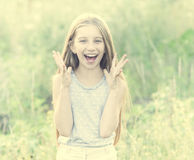 Cute teenage girl with charming smile picking daisies Stock Photos