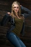 A cute teenage girl dancing. In harsh light Stock Images