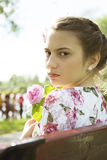 Cute teenage girl on floral dress portrait Stock Photos