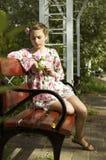 Cute teenage girl on floral dress Stock Photos