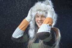 Teenage girl with a fur cap Stock Photo