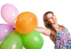 Cute teenage girl holding balloons on white Royalty Free Stock Image
