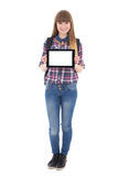 Cute teenage girl holding tablet pc with copyspace isolated on w Stock Photo