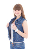 Cute teenage girl in jeans vest isolated on white Royalty Free Stock Image