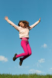 Cute teenage girl jumping with joy Royalty Free Stock Image