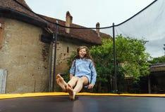 Cute teenage girl jumping on trampoline Royalty Free Stock Photo