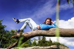 Cute teenage girl lie down on wood Royalty Free Stock Photo