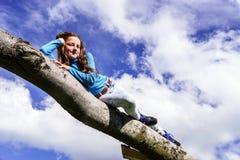 Cute teenage girl lie down on wood Royalty Free Stock Photos