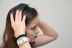 Girl listening music via headphones Stock Photos