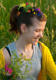 Cute teenage girl picking flowers on the meadow Stock Photography