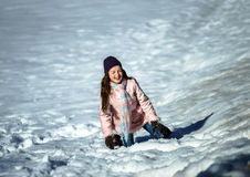 Cute teenage girl playing in white snow Stock Images