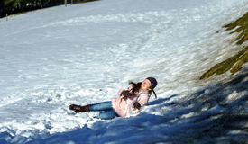 Cute teenage girl playing in white snow Stock Photos