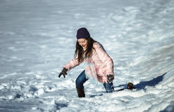 Cute teenage girl playing in white snow Stock Photography