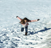 Cute teenage girl playing in white snow Royalty Free Stock Photography