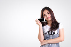 Cute teenage girl pose with smartphone, isolated copy-space Royalty Free Stock Image