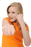 Cute teenage girl punching. Isolated on a white background royalty free stock image