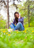 Cute teenage girl relaxing in spring park Stock Image